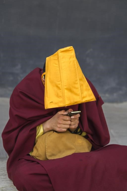 Texting Monk, copyright © Joe Whittington