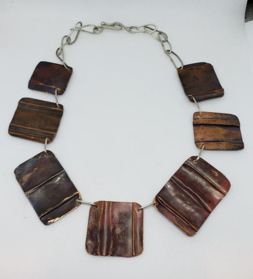 Folded and Textured Copper Shapes with Sterling Silver Chain BoHo Necklace, copyright © MONIKA PIAZZA