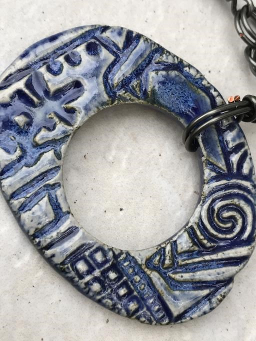 Blue Rustic Necklace with Iridescent Czech Beads and Hematite Accents, copyright © Angela Brasser