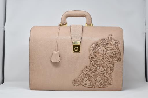 Goatskin Leather Bag with Magnolia Carving, copyright © Takeshi Yonezawa